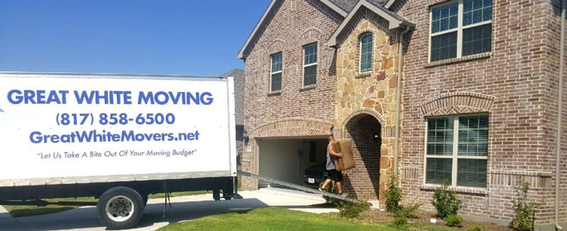 A Great White Moving Company truck arrives at the destination home.