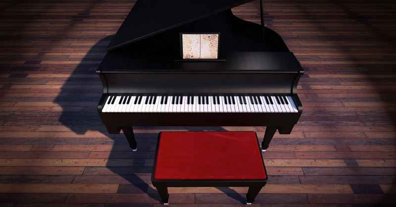 Piano and stool standing on wooden floor