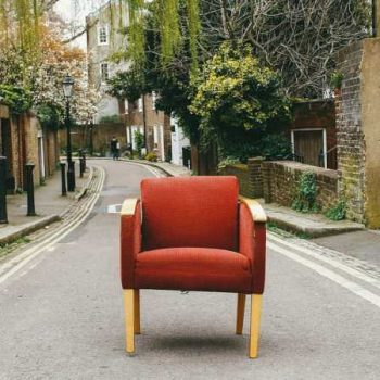 Orange chair standing in street