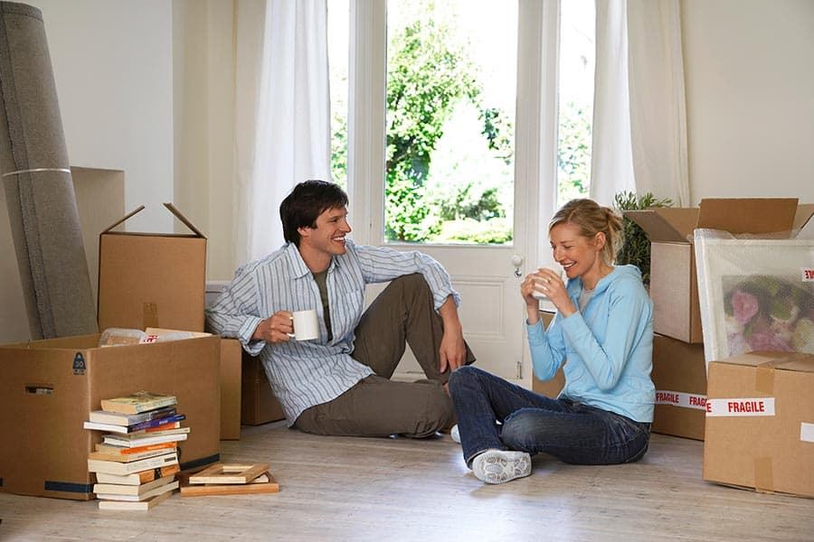 Happy couple taking a break during a move