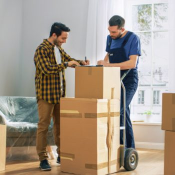 Man happily signing for a moving company