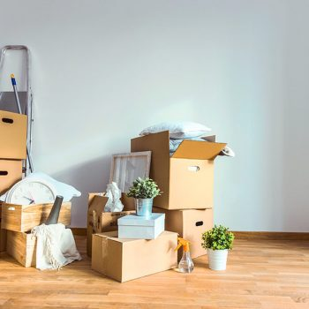 Moving boxes overflowing with too many household objects