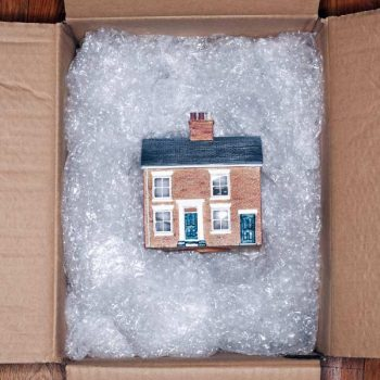 Model of a house in a box padded with bubble wrap