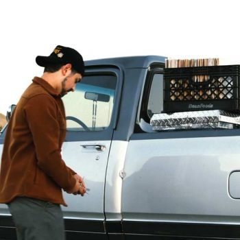 Man loading items into a pickup to take to Goodwill
