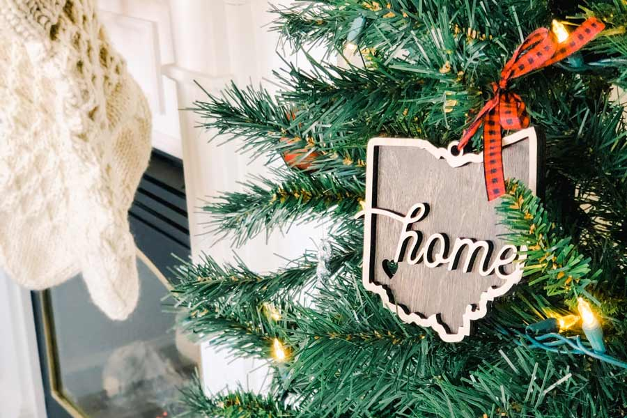 "Christmas tree with an ornament with the text ""Home"""