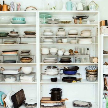 Shelves full of old kitchen items and other clutter
